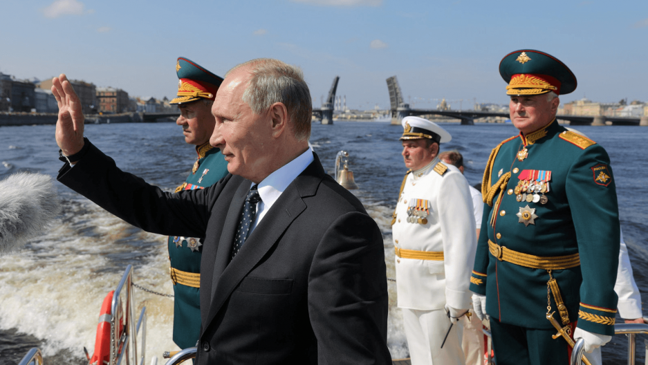 Russian President Vladimir Putin, Defense Minister Sergei Shoigu and Commander of Western military district Colonel-General Andrei Kartapolov