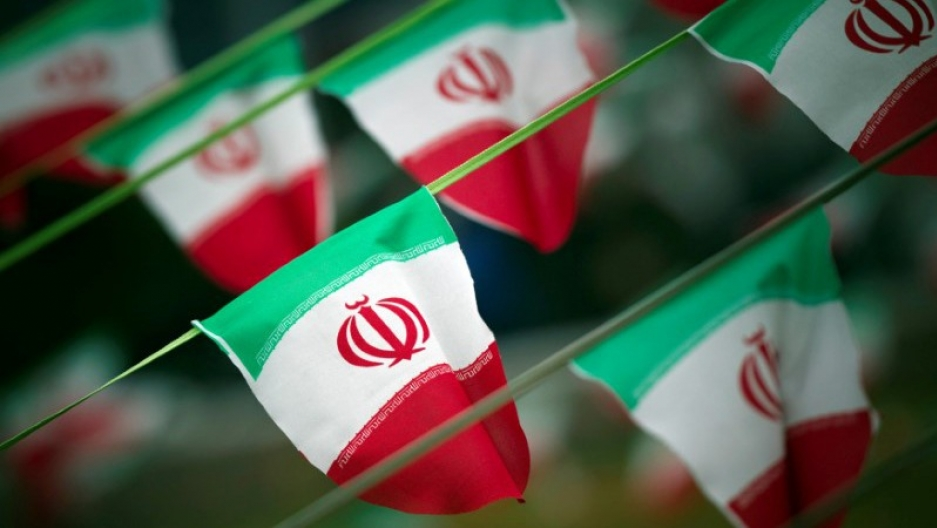 Iran's national flags are seen on a square in Tehran.