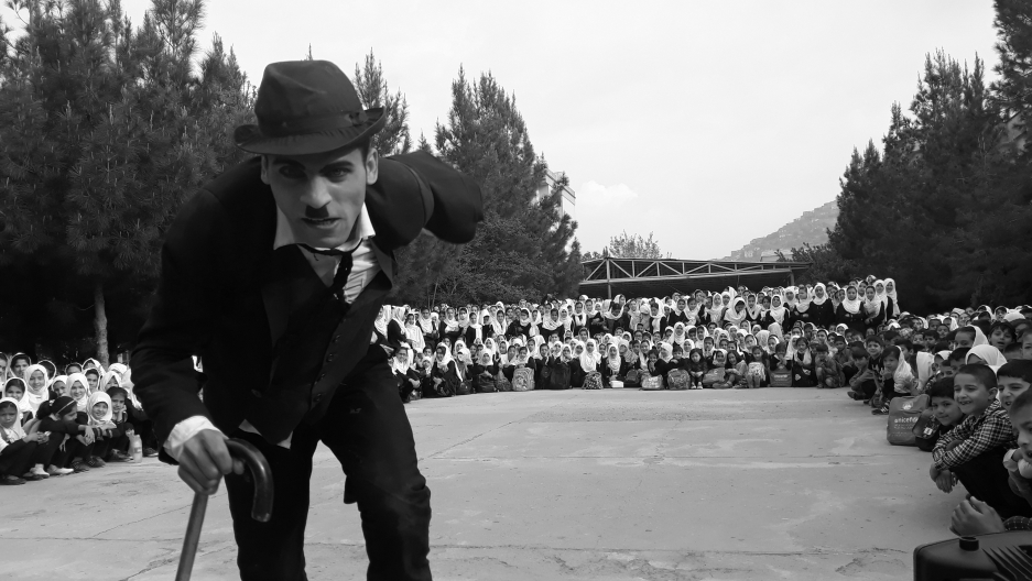 Karim Asir performs for school kids in Kabul, Afghanistan.