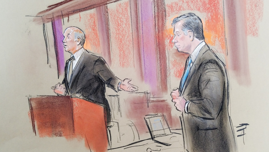 Attorney Tom Zehnle gestures with his left arm to his client, former Trump campaign manager Paul Manafort, in a court room sketch.