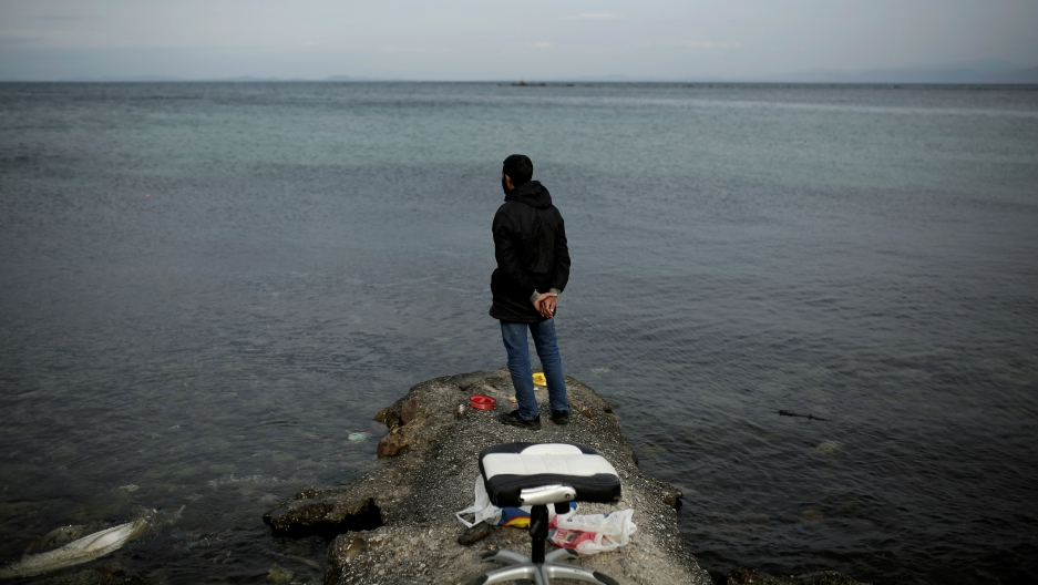 Syrian refugee Muhammad, 42, looks at the sea while fishing in the city of Mytilene, on the island of Lesbos, Greece, Dec. 2, 2017.