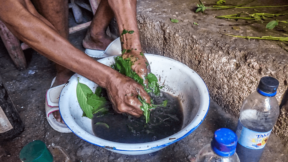a woman prepares herbs for a treatment