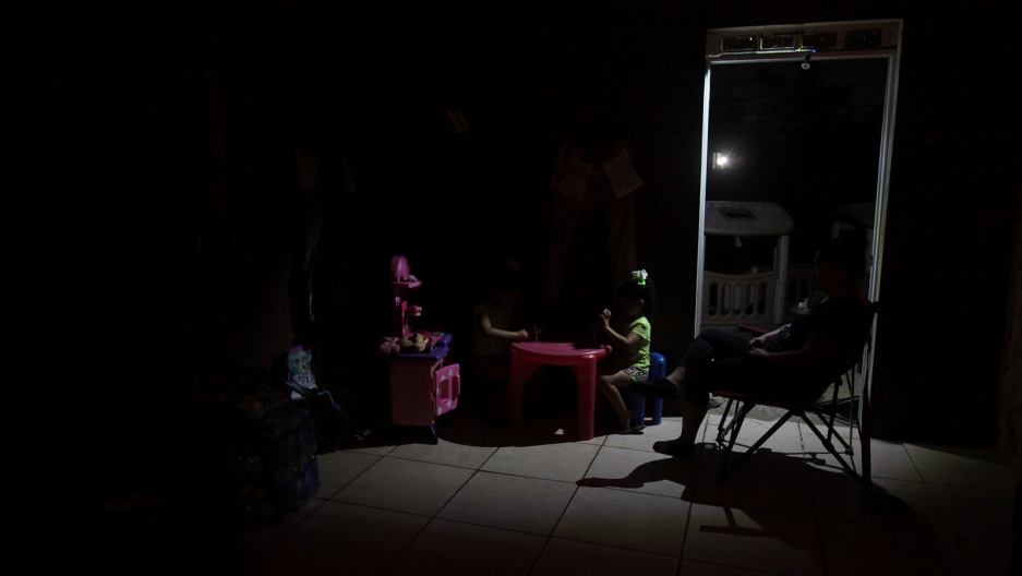 children play in the dark in puerto rico 8 months after hurricane maria