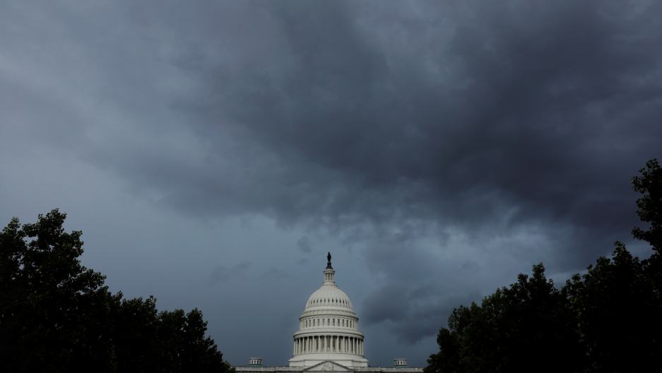 the US capitol under dark clouds