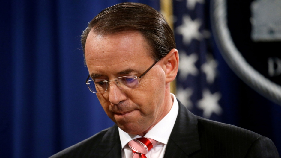 Deputy US Attorney General Rod Rosenstein is shown looking down and red stripped tie.