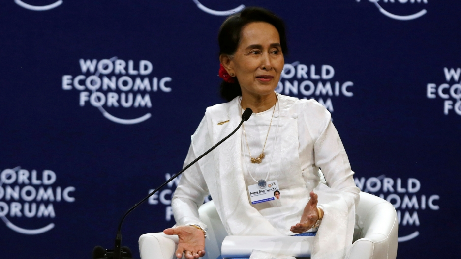 Aung San Suu Kyi  on a stage dressed in white