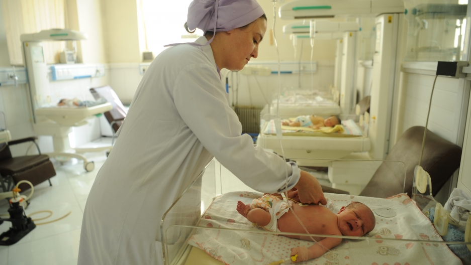 A nurse attends to a newborn at the Malalai Maternity Hospital in Kabul, Afghanistan.