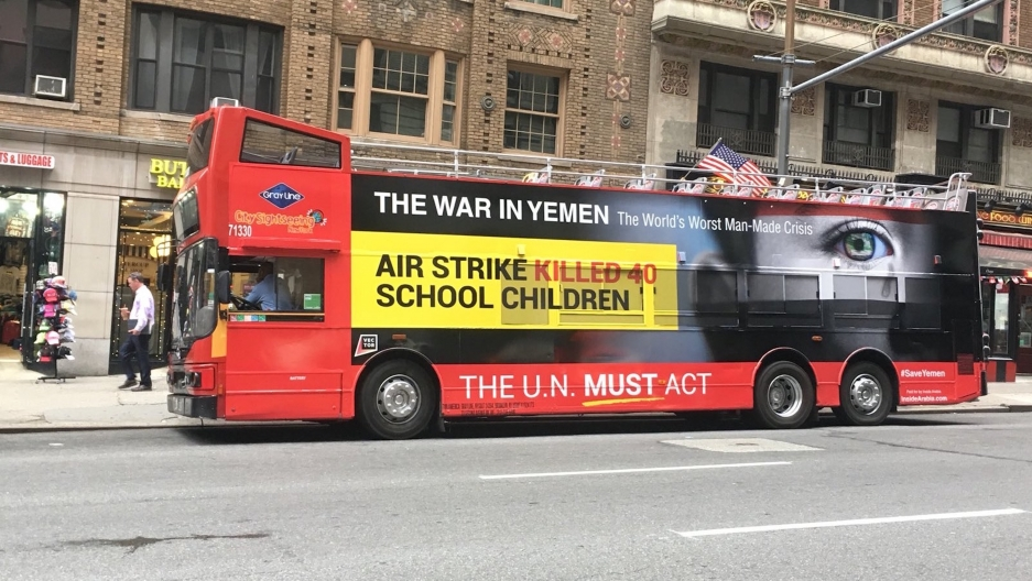 This bright red New York City tour bus carries a message about the war being fought in Yemen.