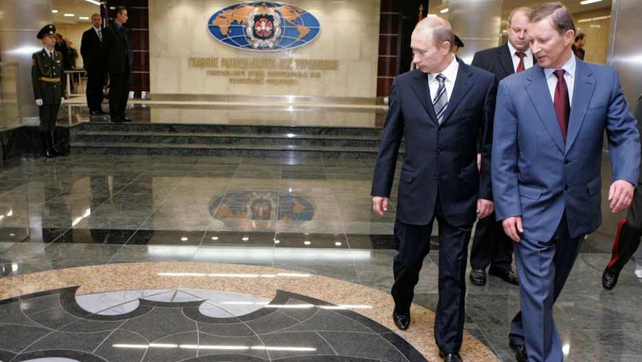 Russian President Vladimir Putin and Defense Minister Sergei Ivanov are shown walking past a marble floor depicting a bat at the new GRU military intelligence headquarters building in Russia.