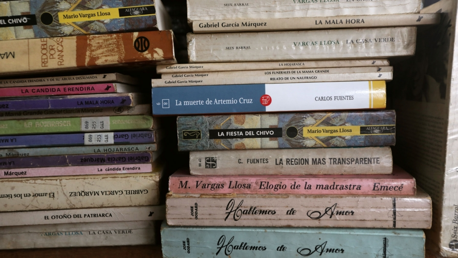 Books are shown in stacks, one of them is by Peruvian-Spanish writer Mario Vargas Llosa, winner of the 2010 Nobel Prize in Literature.