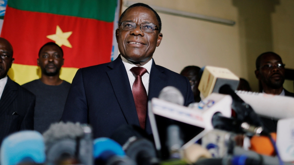 Cameroon opposition candidate smiles during a news conference at his headquarters in Yaoundé, Cameroon