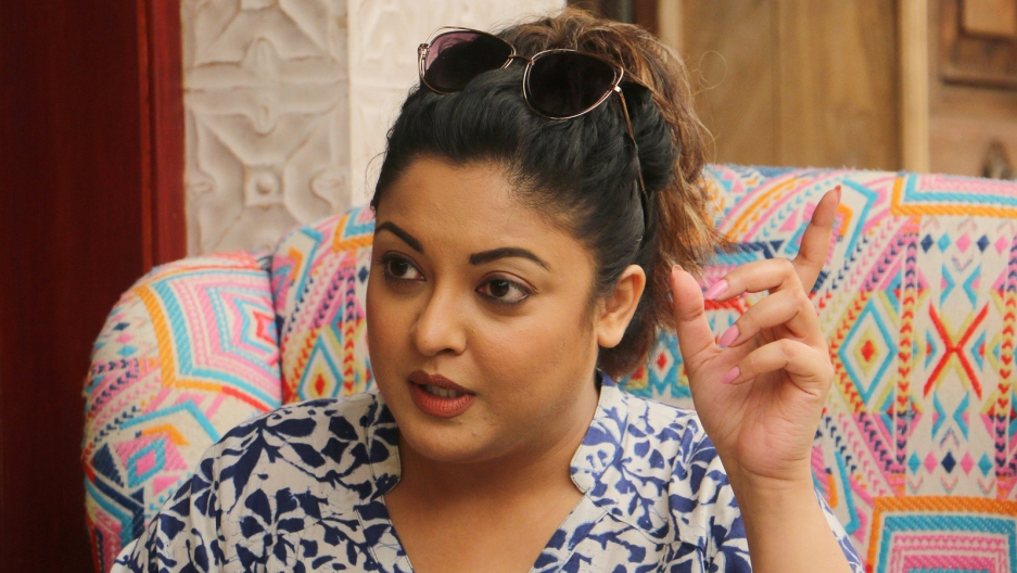 Bollywood actress Tanushree Dutta sits in a chair and gestures as she talks to reporters in Mumbai, India