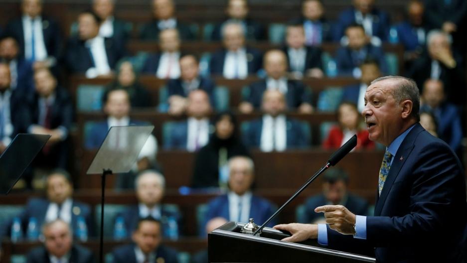 Turkish President Tayyip Erdoğan is shown at a podium addresses members of parliament in Ankara, Turkey.