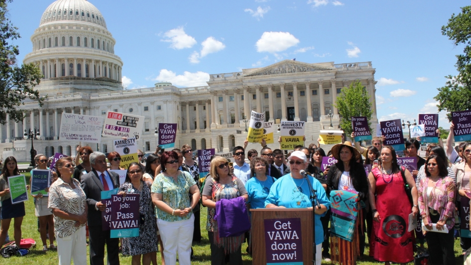 NCAI First Vice President addresses VAWA rally attendees at podium
