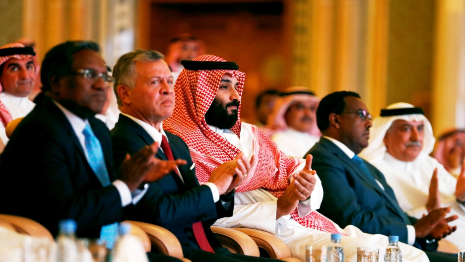 Saudi Crown Prince Mohammed bin Salman (center) is shown sitting in a row along with Jordan's King Abdullah II ibn Al Hussein.