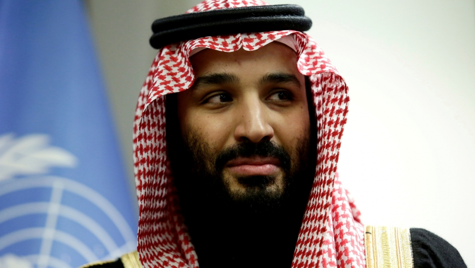 Crown Prince Mohammed bin Salman wears traditional red and white checkered scarf headdress.