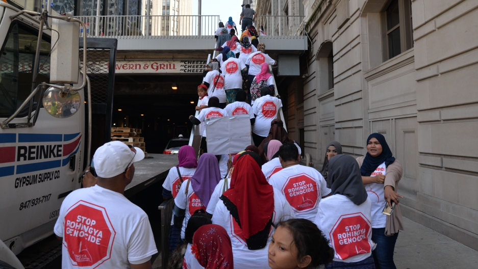 A group of people heading to a demonstration are going up a stairway in downtown Chicago.