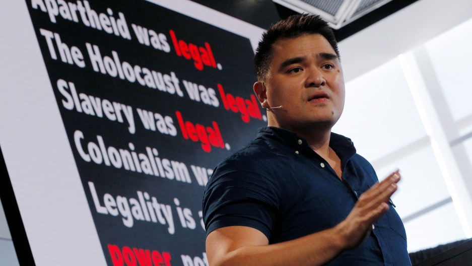 Jose Antonio Vargas speaks in front of a black background with white lettering