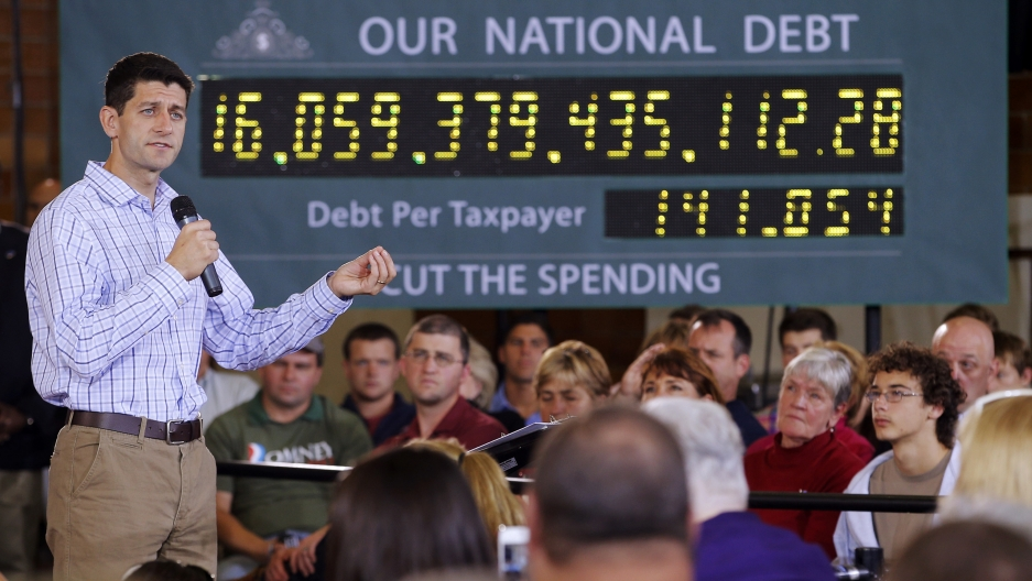 "Republican vice-presidential candidate U.S. Congressman Paul Ryan speaking in front of the campaign's ""national debt clock"" in Dover, New Hampshire September 18, 2012."