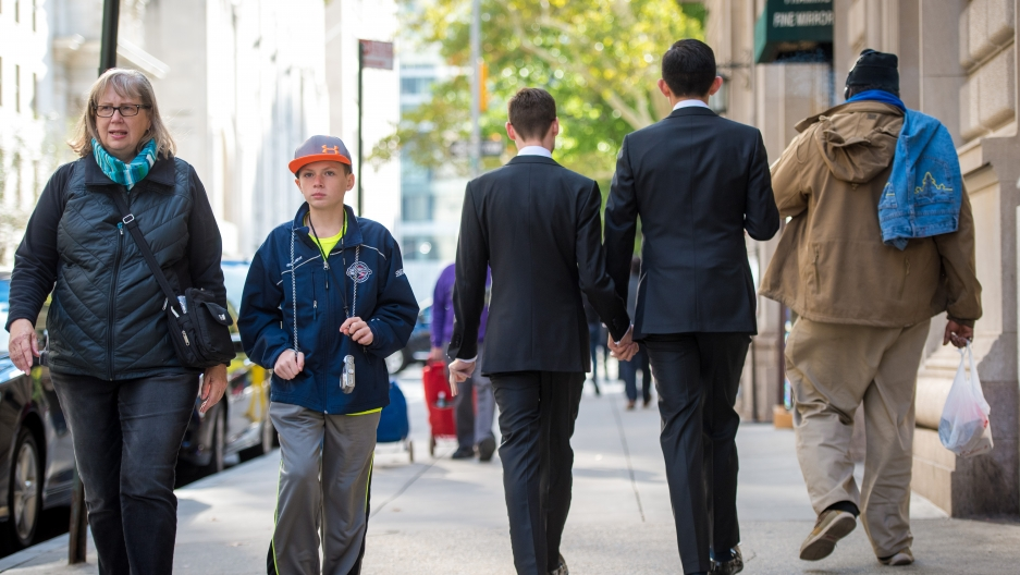Two men in suits walking down New York steet