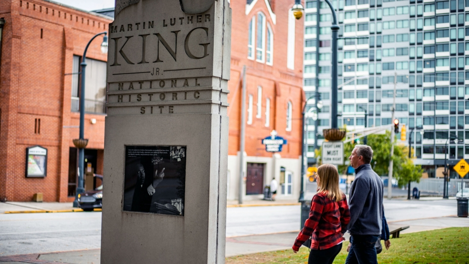 People walk by the MLK historical site in downtown Atlanta.