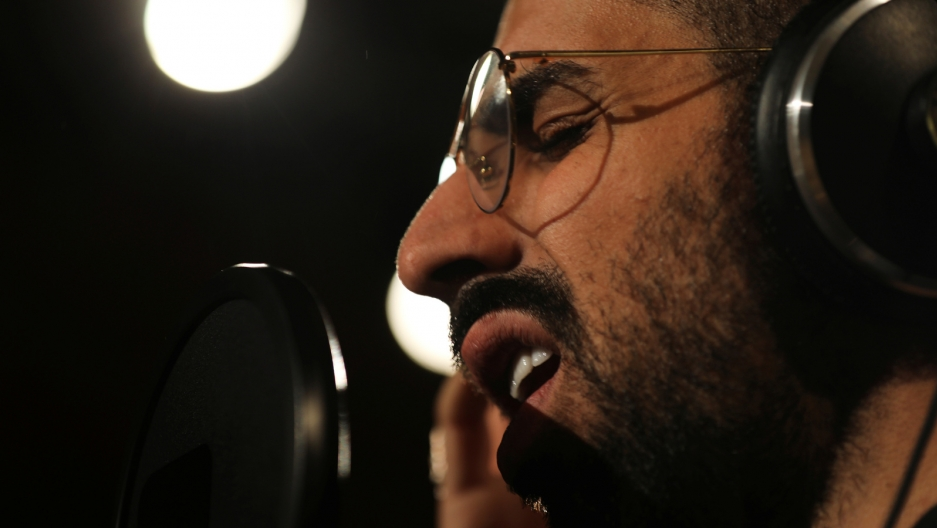 Palestinian musician Bashar Murad works at a recording studio in Sheikh Jarrah, East Jerusalem, Nov. 19, 2018.