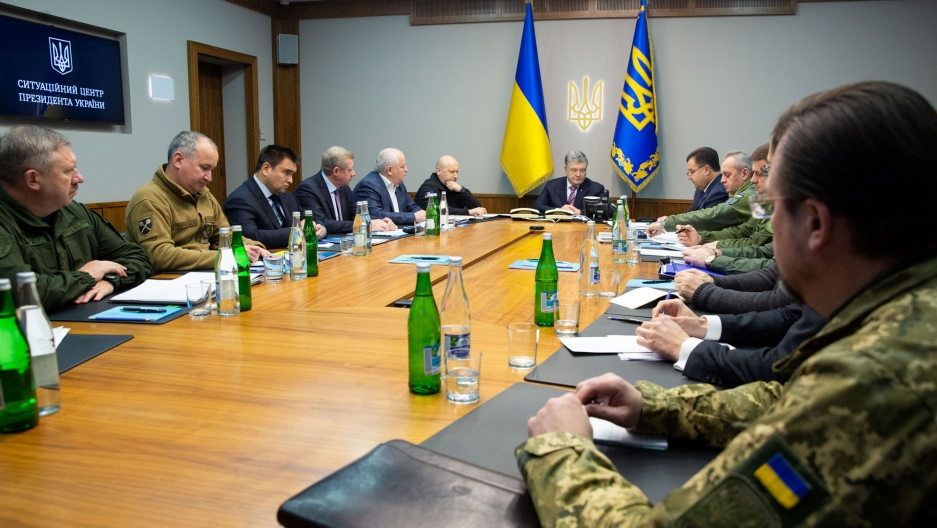 Ukrainian President Petro Poroshenko is shown sitting at the end of a table chairing a meeting with heads of military and security forces in Kiev, Ukraine, Nov. 30, 2018.