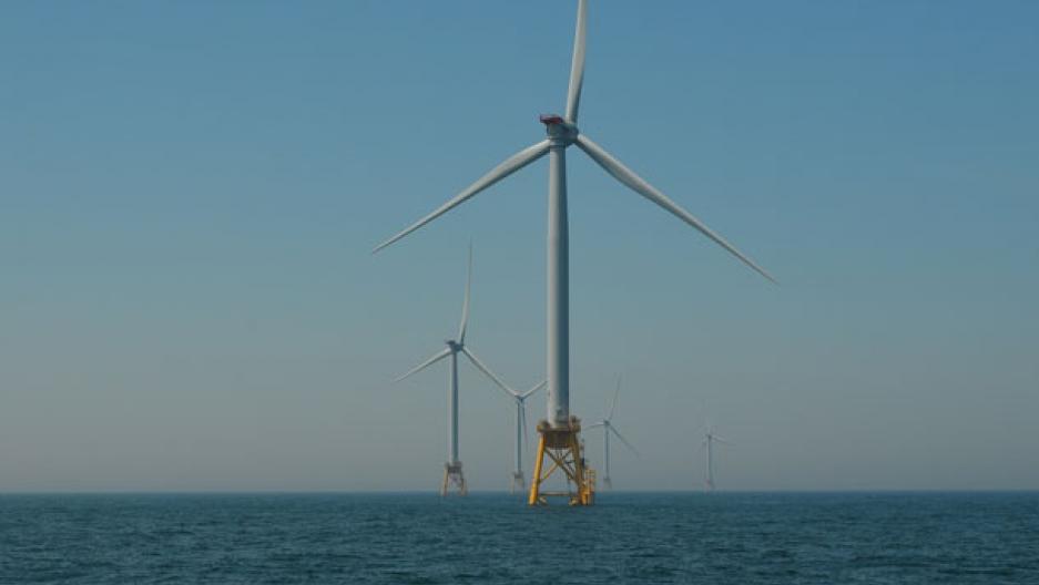 Wind turbine against a blue sky.