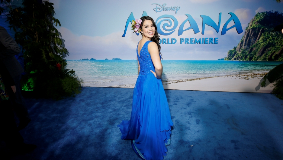 Auli'i Cravalho in a long blue dress