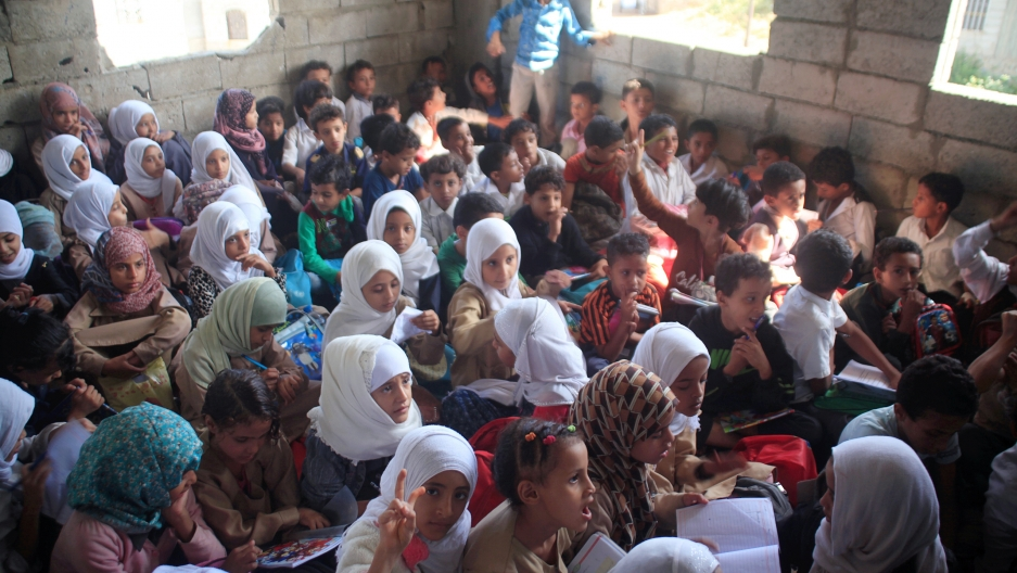 Students attend a class at the teacher's house, who turned it into a makeshift free school that hosts 700 students, in Taiz, Yemen October 18, 2018.