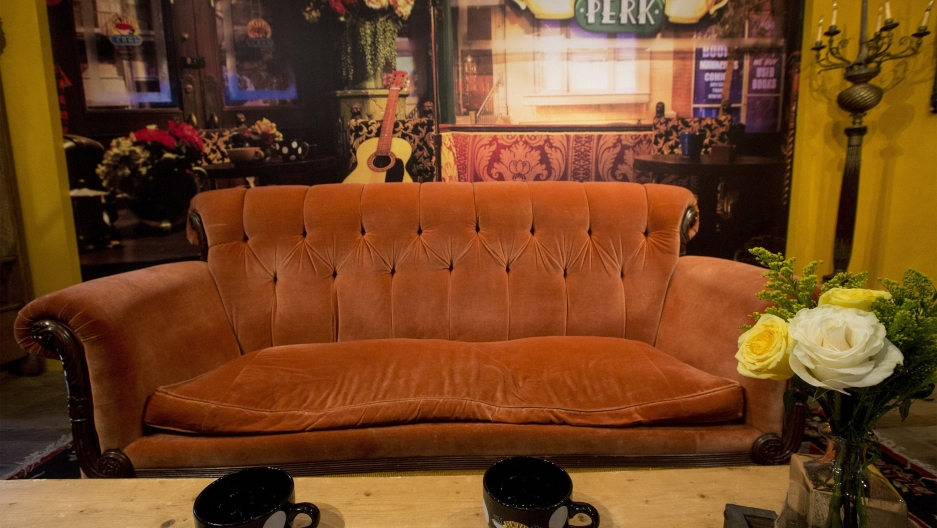 an orange couch in a cafe