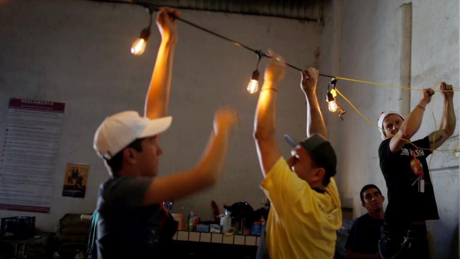 People string lights in a dark room