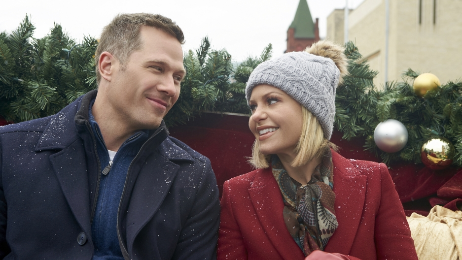 "Luke Macfarlane and Candace Cameron Bure in ""A Shoe Addict's Christmas."""