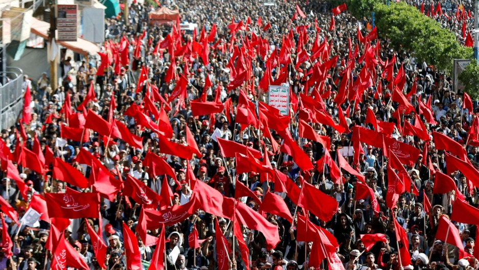 A sea of red flags wave as Yemeni Houthi protest.
