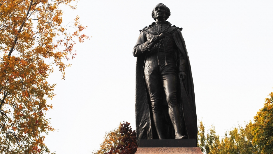 John A. Macdonald's statue against a grey sky