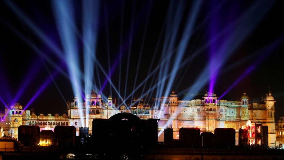 A view of the illuminated City Palace that is colored with different lights