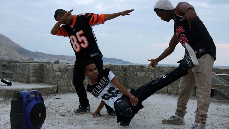 Three young men in hip-hop dance poses