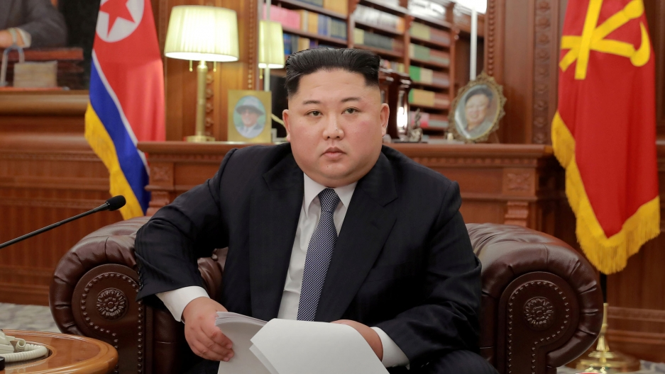 North Korean leader Kim Jong-un is shown in this file photo wearing a dark suit and sitting in a leather armchair.