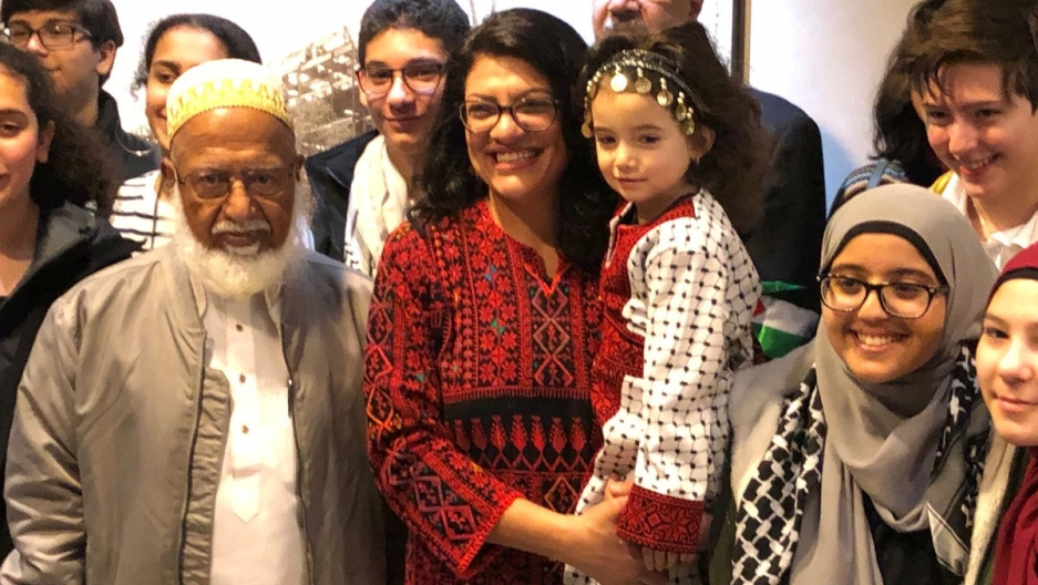 Congresswoman Rashida Tlaib (D-MI), the first Palestinian-American elected to the House, poses in her Palestinian thobe, surrounded by friends and family