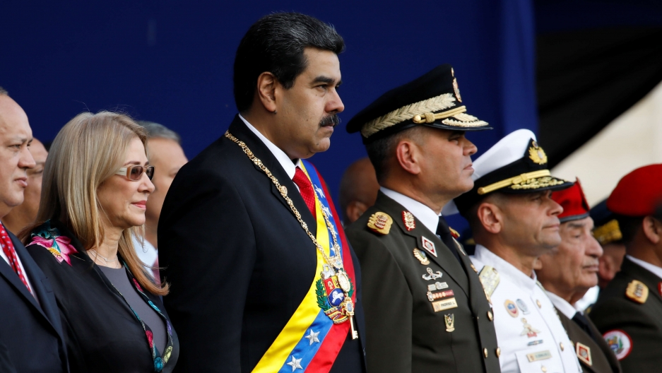 President Nicolas Maduro attends a ceremony in a suit and sash