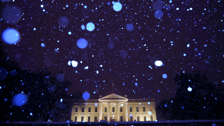 Snow from Winter Storm Gia falls over the White House