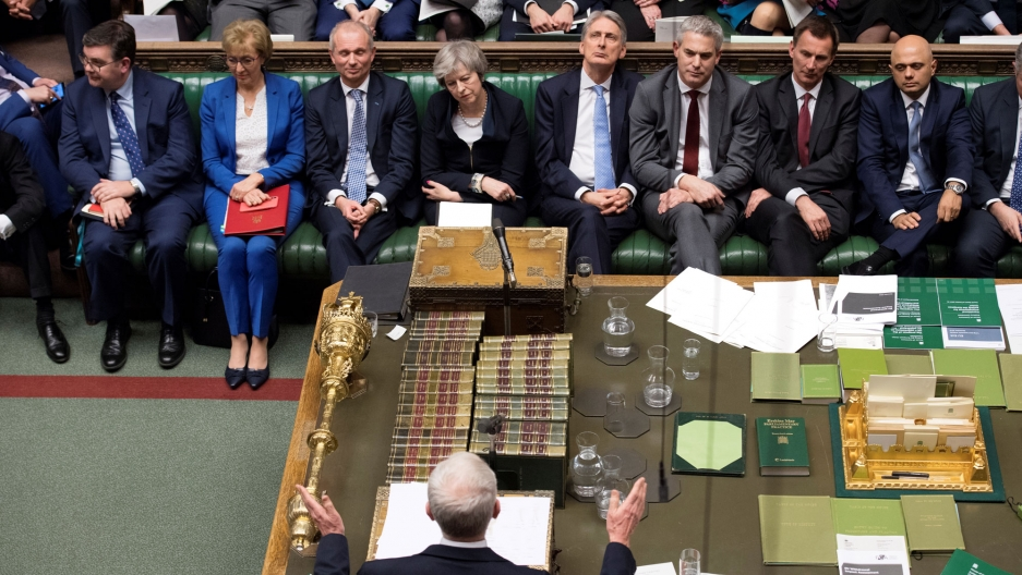 British Prime Minister Theresa May are seen sitting across from Labor Party leader Jeremy Corbyn in Parliament.