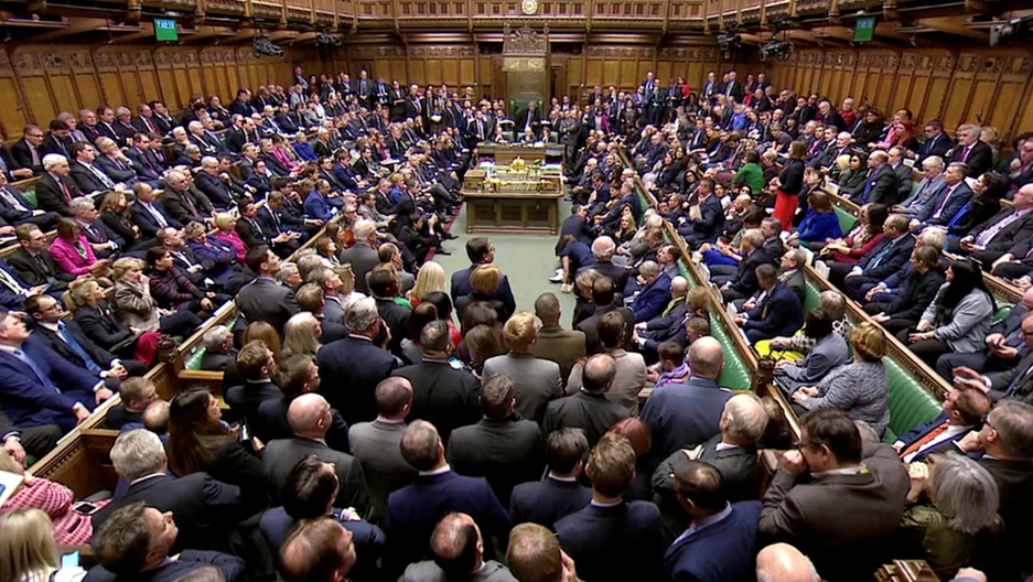 several hundred members of parliament in a room