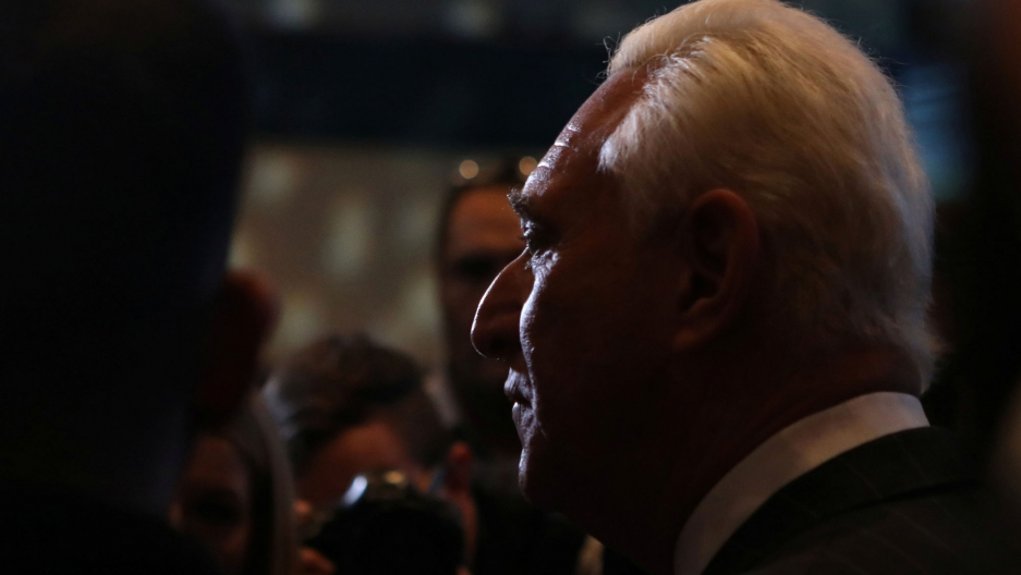 Political operative Roger Stone is shown in a profile portrait in high contrast.