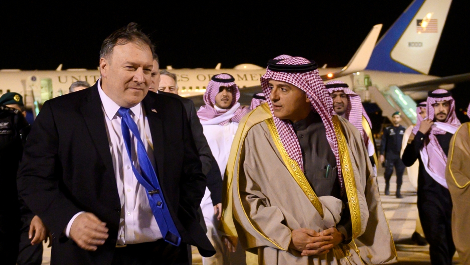 US Secretary of State Mike Pompeo just after departing a plane is greeted by Saudi's Minister of State for Foreign Affairs Adel al-Jubeir in Riyadh, Saudi Arabia on January 13, 2019.