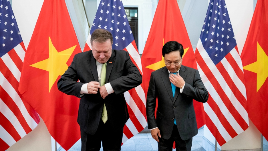 US Secretary of State Mike Pompeo and Vietnamese Deputy Prime Minister and Foreign Minister Pham Binh Minh arrive for a photo opportunity before a meeting at the Ministry of Foreign Affairs in Hanoi, Vietnam, July 9, 2018.