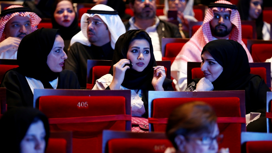 Saudi women attend a concert featuring the Greek perfomer Yanni at Princess Nourah bint Abdulrahman University in Riyadh, Saudi Arabia on December 3, 2017.