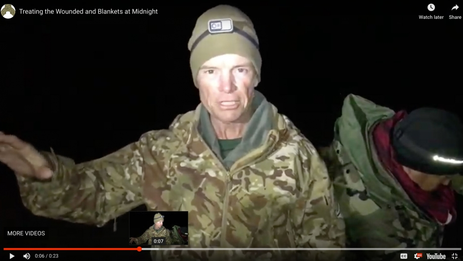 A man in combat fatigues is captured in a YouTube video screen grab