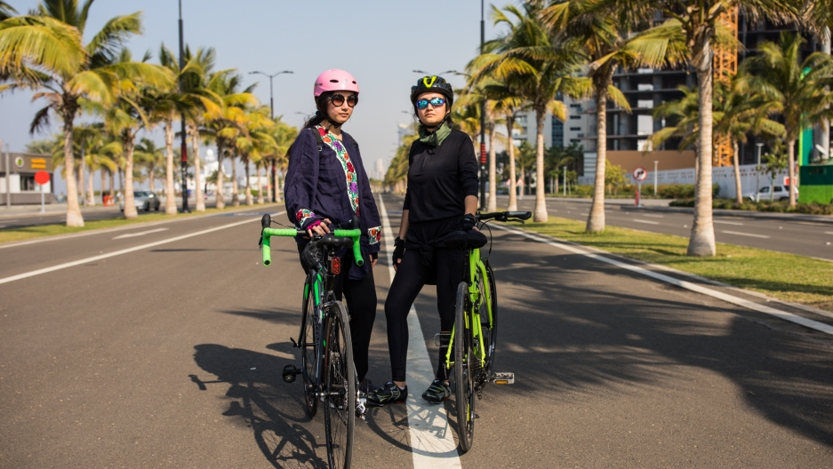 Doaa Naeem (right) and her sister Fatimah Naeem ride their bikes along the Corniche in Jeddah, Saudi Arabia.