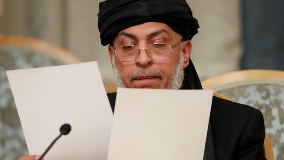 Sher Mohammad Abbas Stanakzai rifles through papers